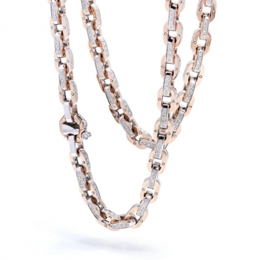 A chain of links in white and pink gold with diamonds