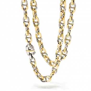 A chain of links in white and yellow gold
